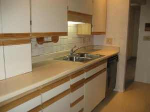 This is what our kitchen cabinets look like.  No, you can't un-see it.  Image from (appropriately enough) UglyHousePhotos.com